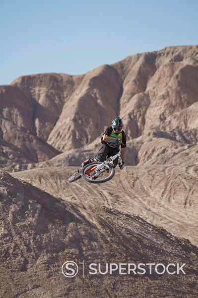 Stock Photo: 1815R-97370 USA, California, Mountain biker jumping in air