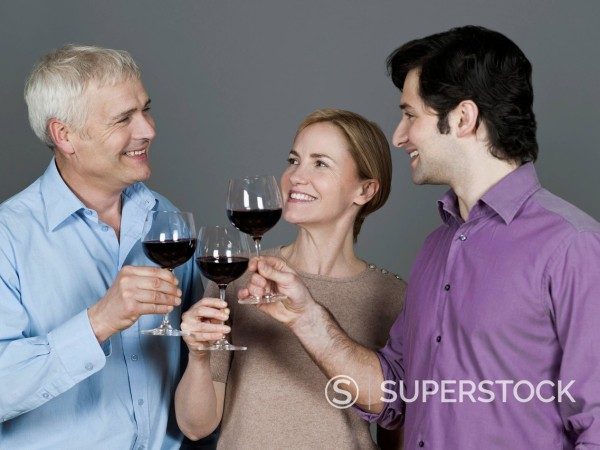 Stock Photo: 1815R-98981 Men and woman with wine glass, smiling