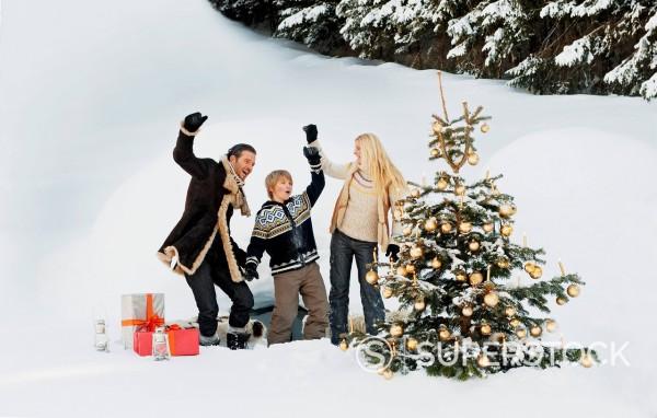 Austria, Salzburg County, Family celebrating christmas in snow : Stock Photo