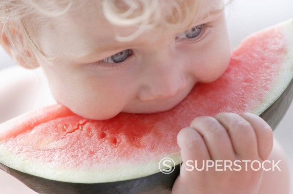 Stock Photo: 1815R-99849 Germany, Bavaria, Boy eating watermelon, close up