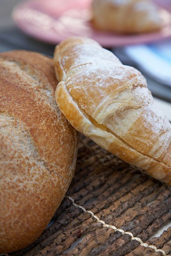 Close-up of breads and pastries on a place mat : Stock Photo