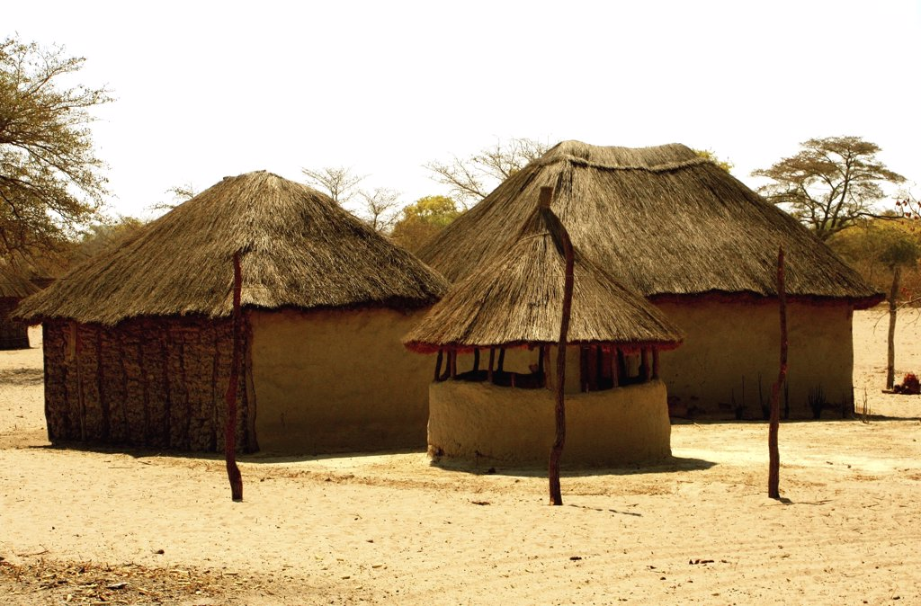 Traditional mud huts in a village, Caprivi Strip, Namibia : Stock Photo