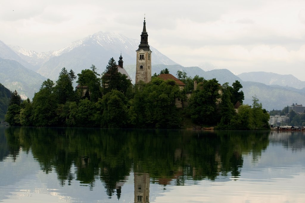 Reflection of a church in water, Santa Maria Church, Lake Bled, Bled, Slovenia : Stock Photo
