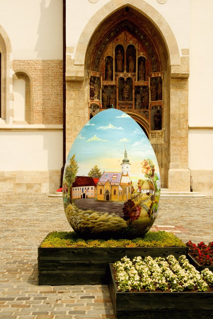 Stock Photo: 1818-255 Sculpture of an Easter egg in the courtyard of a church, St. Mark's Church, Zagreb, Croatia