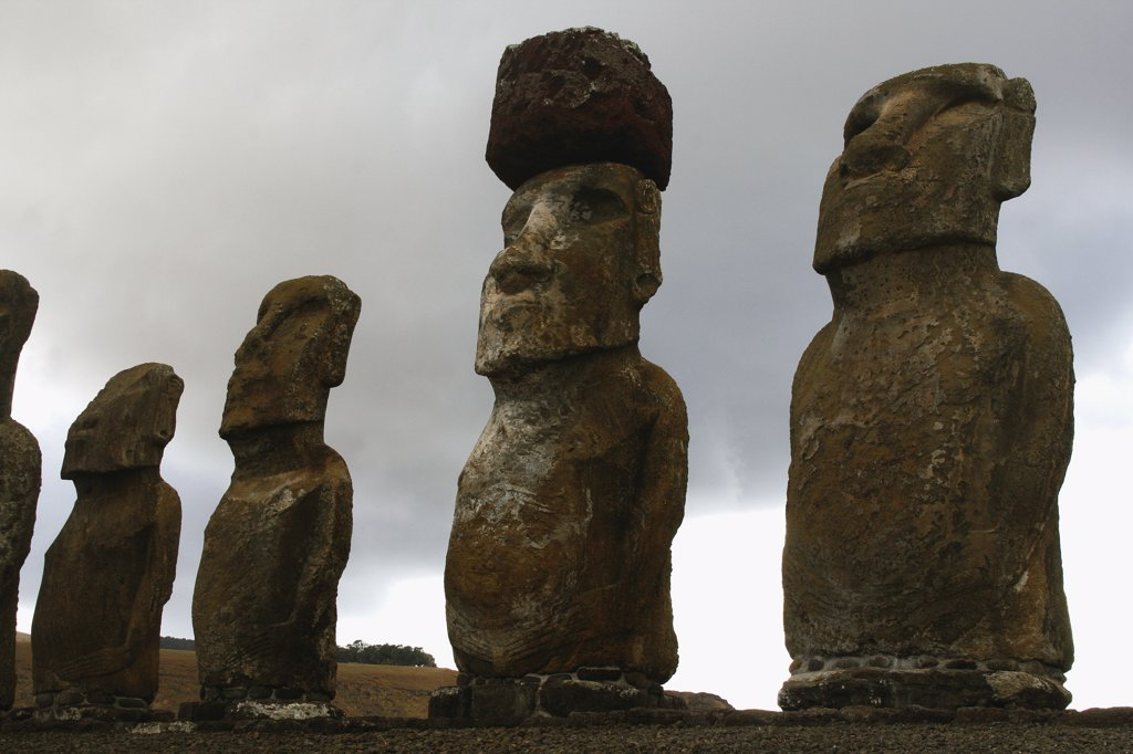 Low angle view of Moai statues, Rano Raraku, Ahu Tongariki, Easter Island, Chile : Stock Photo