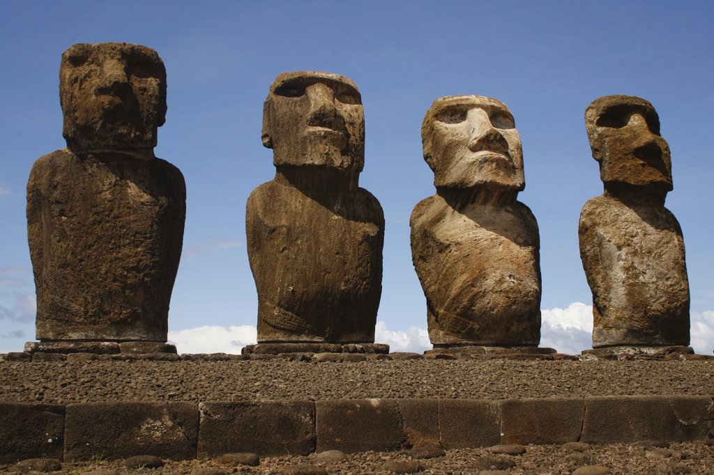 Low angle view of Moai statues in a row, Rano Raraku, Ahu Tongariki, Easter Island, Chile : Stock Photo