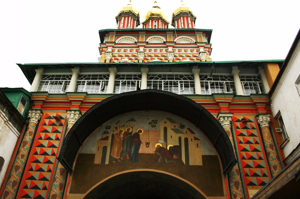Stock Photo: 1818R-454 Entrance to Russian monastery, fresco of saints and mendicants