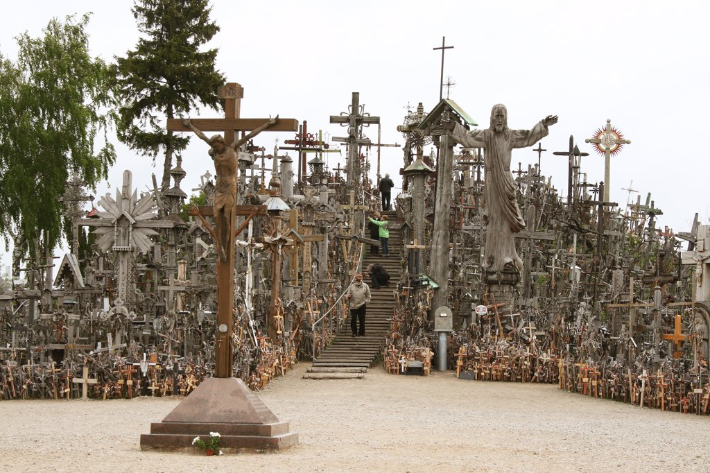 Stock Photo: 1818R-456 Lithuania, Siauliai, Hill of Crosses, Pilgrims on hill
