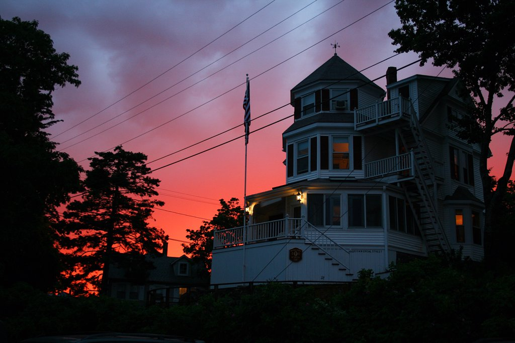 USA, Maine, Boothbay Harbor, old house at sunset : Stock Photo