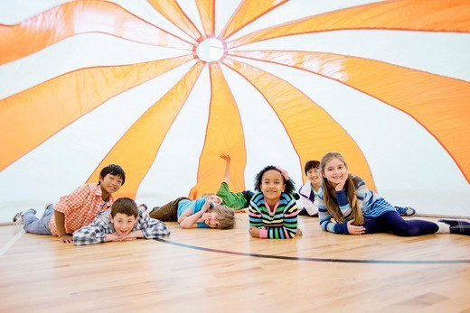 Elementary students playing in gymnasium. : Stock Photo