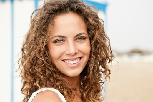 Young woman on beach : Stock Photo
