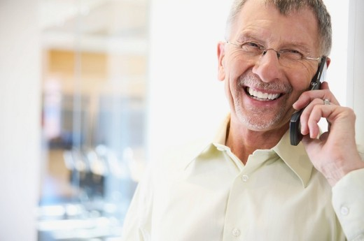 Amused Businessman on Cell Phone : Stock Photo