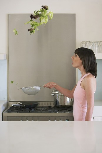 Woman tossing salad : Stock Photo