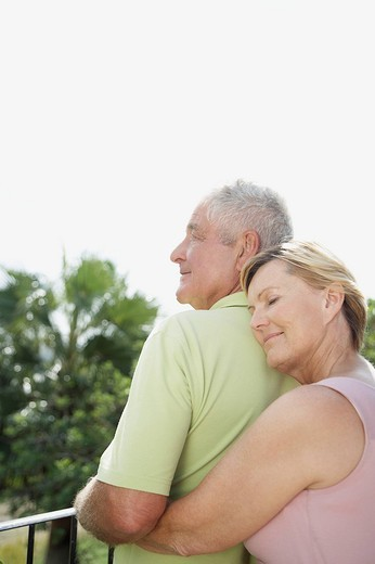 Woman hugging husband : Stock Photo