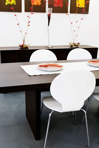 Stock Photo: 1825-1007 Chairs with a table in a dining room