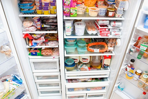 Refrigerator filled with assorted food items : Stock Photo