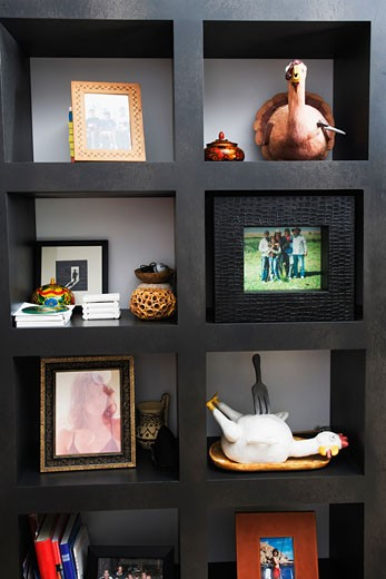 Stock Photo: 1825-1101 Close-up of a shelf with antiques