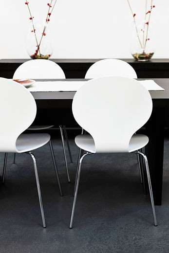 Chairs with a table in a dining room : Stock Photo