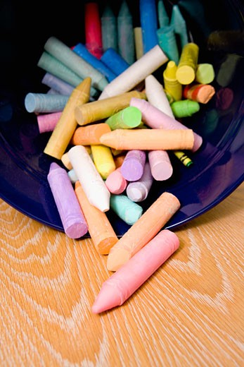 Stock Photo: 1825-1484 Close-up of crayons spilling out from a container