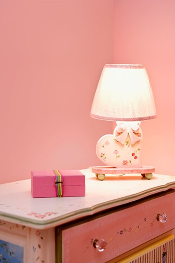 Lamp with a box on a sideboard : Stock Photo