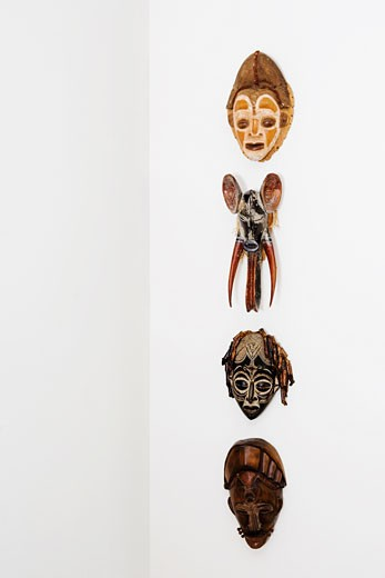 Close-up of masks mounted on a wall : Stock Photo
