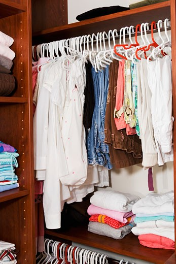 Stock Photo: 1825-1886 Clothing hanging in a closet