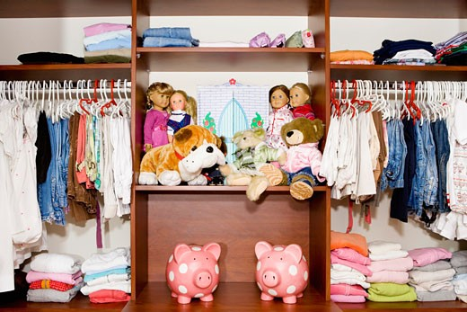 Clothes and toys in a wardrobe : Stock Photo
