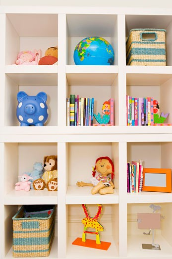 Books and toys on a shelf : Stock Photo