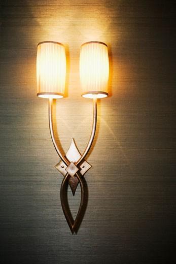 Illuminated lamp mounted on the wall : Stock Photo