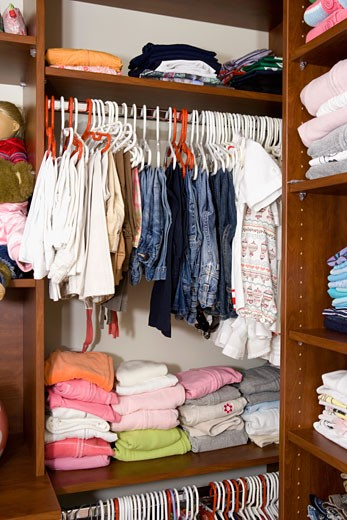 Clothes in a closet : Stock Photo