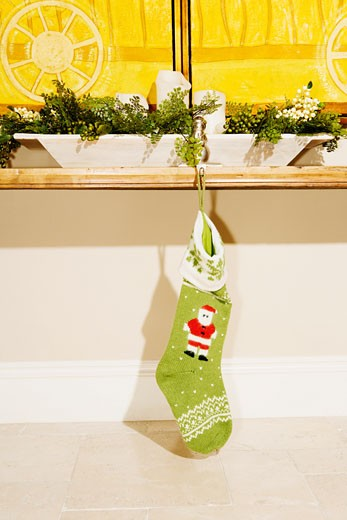 Christmas stockings hanging with a table : Stock Photo