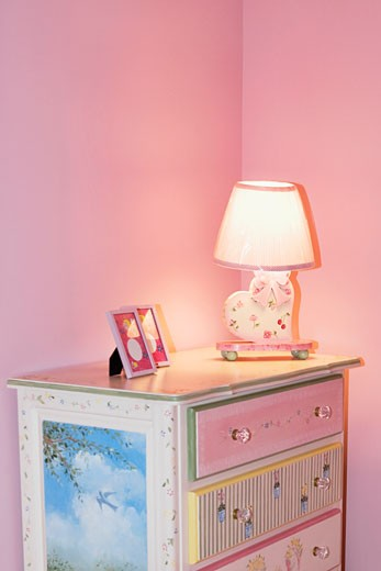 Lamp with a picture frame on a sideboard : Stock Photo