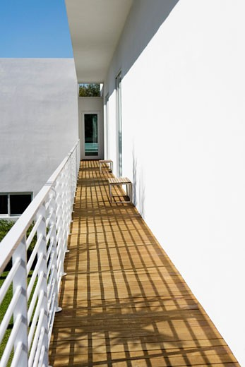 Stock Photo: 1825-2639 Shadow of railing on a balcony