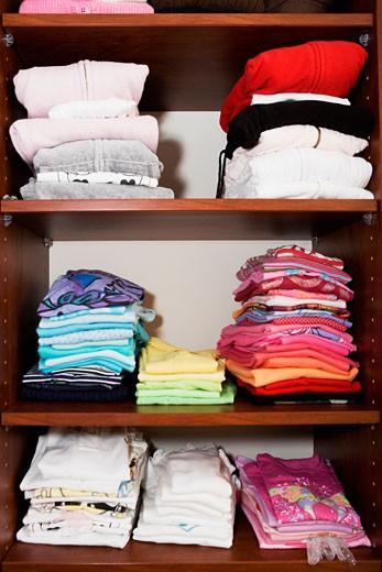 Closet full of clothing : Stock Photo