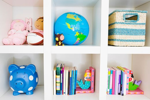 Stock Photo: 1825-3071 Toys and books on a shelf