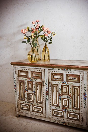 Stock Photo: 1825-3289 Flower vases on a sideboard