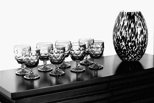 Showpiece with glasses on a sideboard : Stock Photo