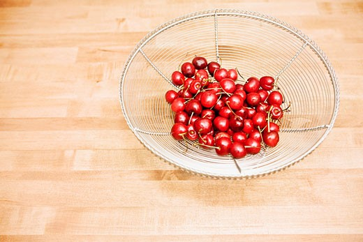 Cherries in a bowl : Stock Photo