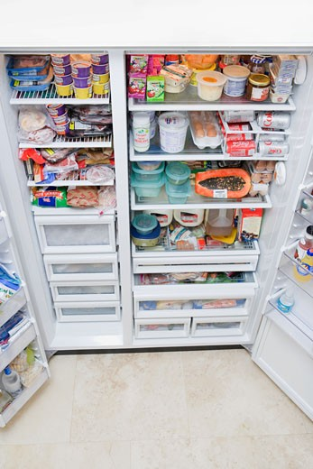 Stock Photo: 1825-3604 Refrigerator filled with assorted food items
