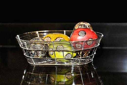 Decorative balls in a basket : Stock Photo