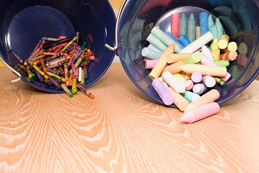 Crayons spilling out from containers : Stock Photo