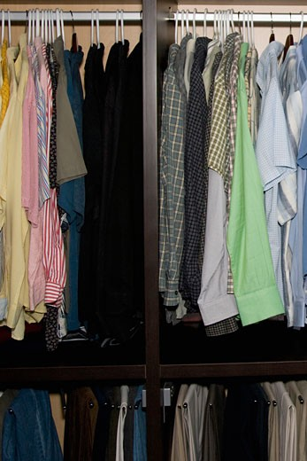 Stock Photo: 1825-3886 Clothes hanging in a clothes rack