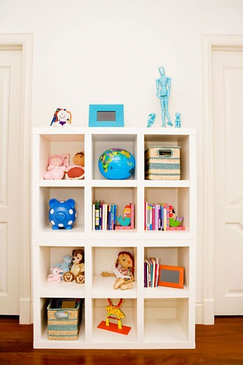 Toys and books in a shelf : Stock Photo