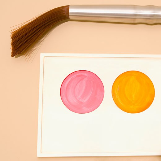 Stock Photo: 1825-4164 Palette of watercolor paints with a paintbrush mounted on a wall