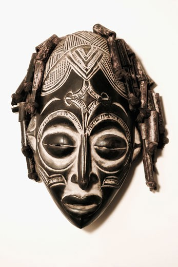 Stock Photo: 1825-4221 Close-up of a mask mounted on a wall