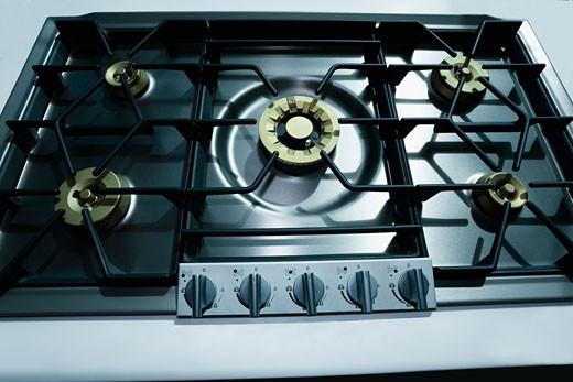 Close-up of a gas stove burner : Stock Photo