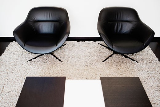 Two armchairs on a carpet : Stock Photo