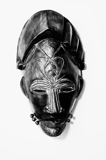 Close-up of a mask mounted on a wall : Stock Photo