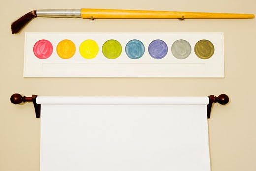 Flipchart and palette with a paintbrush on a wall : Stock Photo