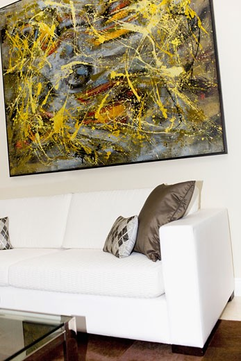Stock Photo: 1825-4575 Couch and paintings in a living room